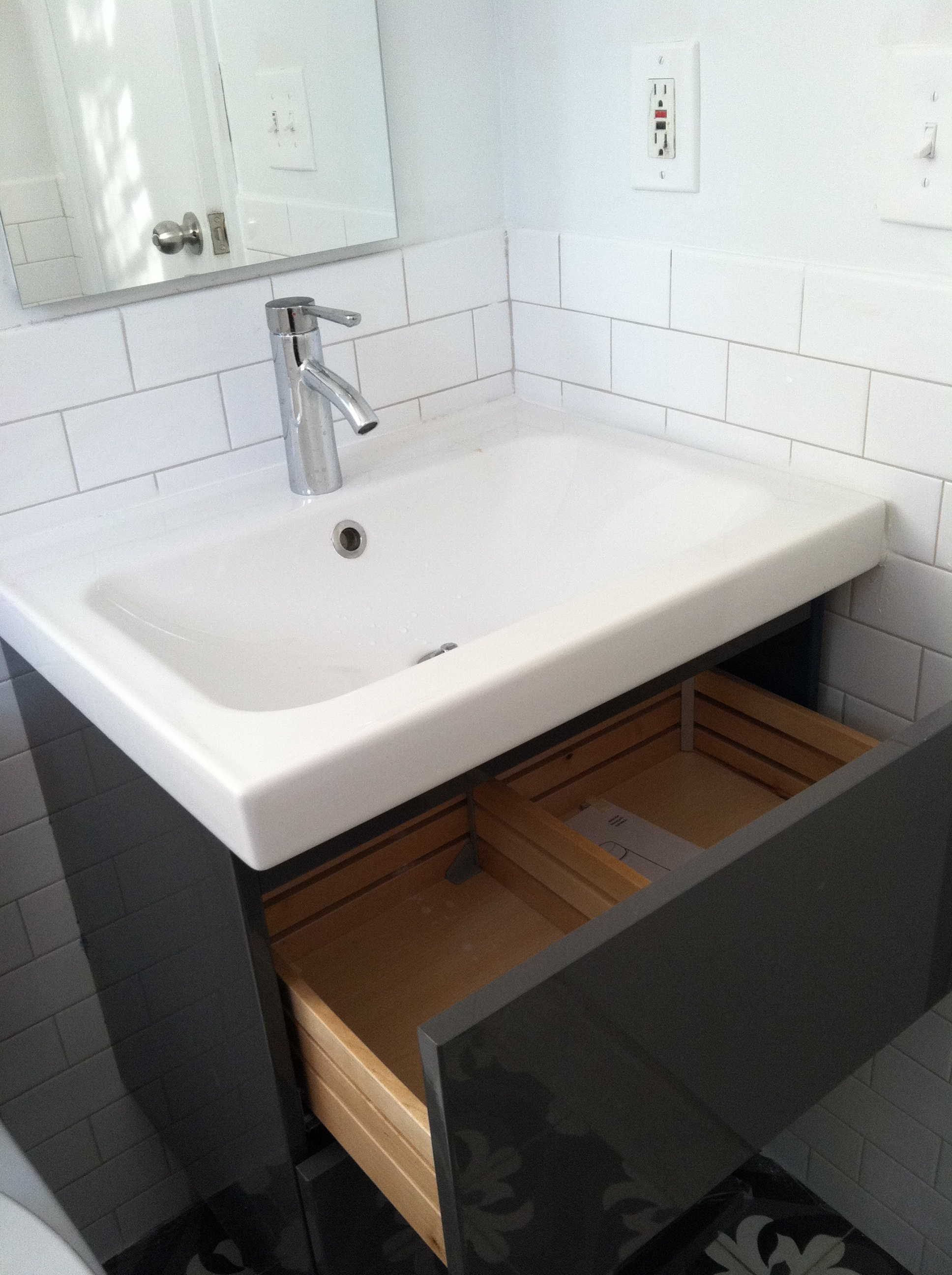 In a tiny bathroom you have to have storage & got the vanity | Loisaida Nest