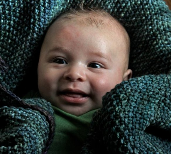 Baby D. in his blue-green blanket