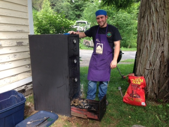 The Bees Knees Cafe's Chef Rob with his file cabinet smoker