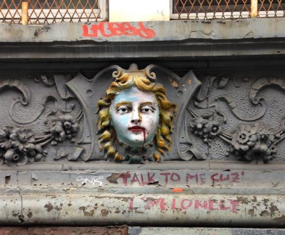 An embellished lady gargoyle on 98 St. Marks Place